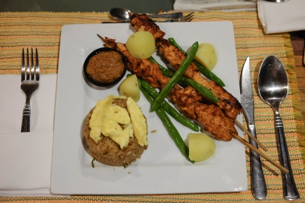Chicken satay with peanut sauce, potatoes, and rice